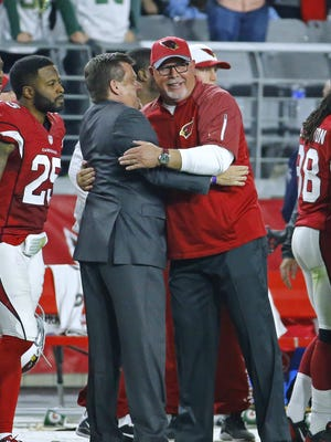 Arizona Cardinals head coach Bruce Arians receives a hug from Cardinals President Michael Bidwill after their 38-8 win over the Green Bay Packers in their regular-season matchup on Dec. 27, 2015 in Glendale.