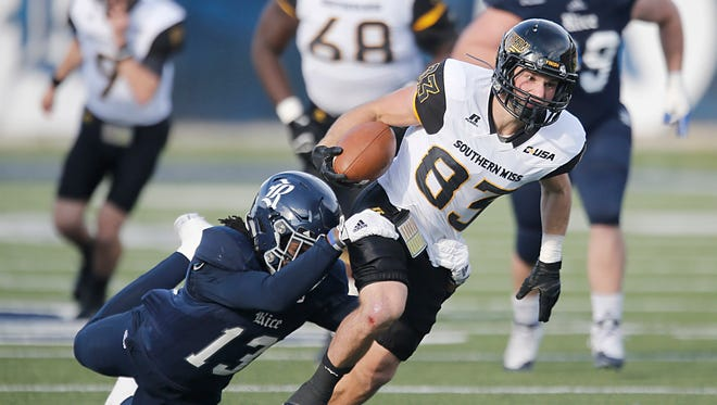 Southern Miss wide receiver Casey Martin is tackled by Rice safety Destri White on Saturday during their game in Houston, Texas.
