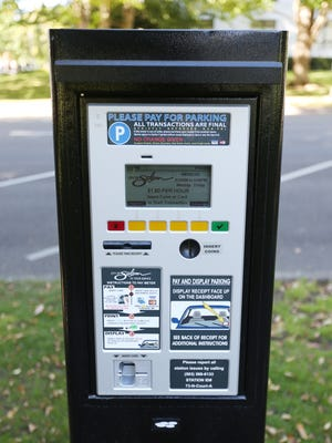 One of the new parking meter pay stations along Court Street near the Oregon State Capitol in Salem.
