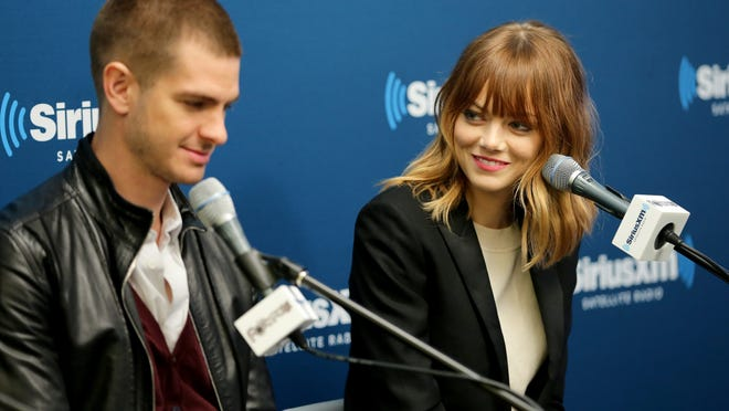 """NEW YORK, NY - APRIL 24:  Actors Andrew Garfield (L) and Emma Stone of the cast of """"The Amazing Spider-Man 2"""" answer questions from fans during a SiriusXM 'Town Hall' special with host Jamie Foxx on SiriusXM's The Foxxhole channel at the SiriusXM Studio on April 24, 2014 in New York City.  (Photo by Neilson Barnard/Getty Images for SiriusXM)"""