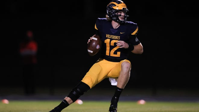Prince Avenue's Brock Vandagriff (12) looks to pass during a GHSA high school football game between Prince Avenue Christian and Athens Academy in Bogart, Ga., on Friday, Oct. 23, 2020.
