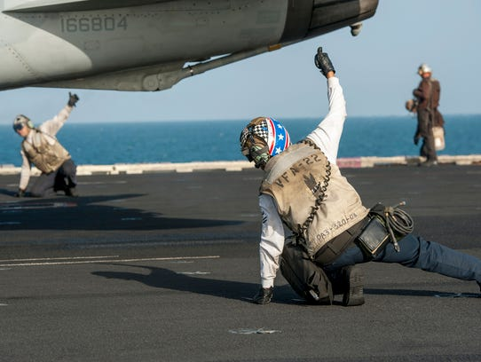 In this photo released by the U.S. Navy on Dec. 5,