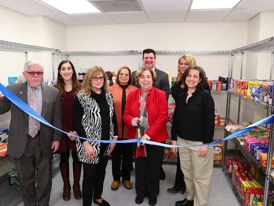 At the ribbon-cutting, (from left) Mark McCormick,