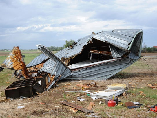 Twisted metal is all that remains of the shell of Doug Beethe's garage after a tornado on May 22, 2008, ripped the garage off its foundation and planted it in a field about 75 yards north.
