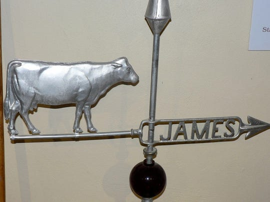 Most dairy barns were topped by a weather vane. The Oncken barn had a cow like this one on display at the museum.