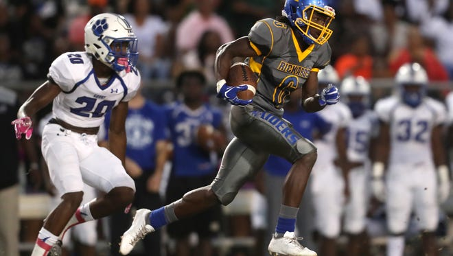 Rickards Ferante Cowart runs downfield after making a catch against Godby during their game at Cox Stadium on Friday night.