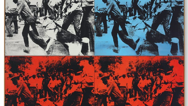 """This undated photo provided by Christie's shows Andy Warhol's 1964 """"Race Riot,"""" in four parts painted with acrylic and silkscreen ink on linen."""