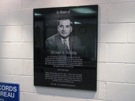 A plaque bearing the likeness of Michael Pollotta.