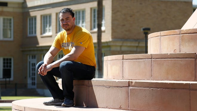 Arizona State University student David Montenegro sits out in front of the Hayden Library building at ASU on May 10, 2018. Montenegro and more than 2,300 public college students around Arizona with deferred deportation status must now pay thousands more in tuition annually starting this fall under a state Supreme Court decision eliminating their lower in-state tuition.