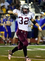 Shippensburg's Nicholas Weltz celebrate a fumble recovery.
