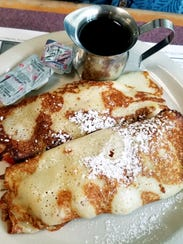 Galaxy Diner's strawberry cream cheese crepes were