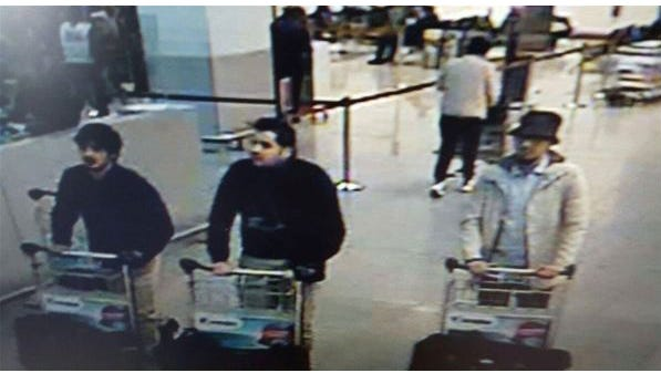 A picture released on March 22, 2016 by the Belgian federal police prosecutor shows a screengrab of the airport CCTV camera showing three suspects of the attacks at Brussels Airport, in Zaventem.