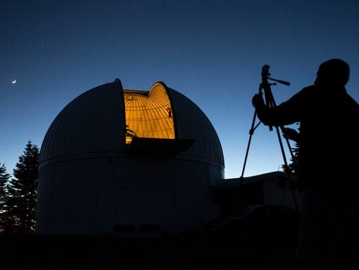 Joel Rhymer, a visiting science teacher from Fryeburg Academy in Maine, gets ready to photograph an observatory on May 31, 2014, at the Mt. Lemmon SkyCenter.