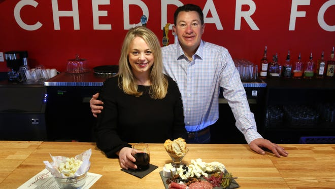 Andrea and Scott Robbins, owners of Urban Stead Cheese in Walnut Hills. The cheesemakers opened in 2018. In addition to making a variety of cheeses for sale, they have a full bar and a menu that includes cheese plates.