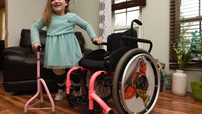 Ava McCulloch, 8, and her wheelchair and crutches. McCullough needs a new wheelchair so she can get around over a diverse range of terrains. McCullough has spina bifida.