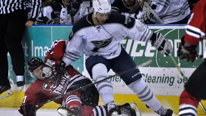 Ice Flyers defenseman Brandon Blair, right,, gets tangled up with one of the Fayetteville FireAntz during a game earlier this season. The two teams meet in the quarterfinals of the SPHL playoffs on Tuesday.