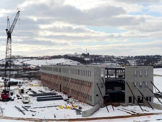 Work continues on a three-story office building at