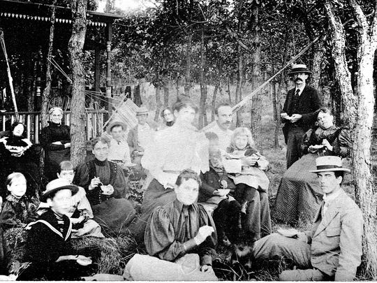 The family has a picnic shorlty after the purchase of the home for $332.50 by M.T.V. Bowman and daughter Leona Bowman d'Orsay, who is at the center of the photo next to husband Alonzo, with daughter on his lap.