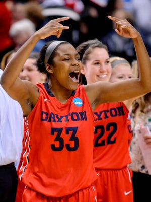 Dayton guard and former Ballard High player JaVonna Layfield (33 here, now wears 34) celebrates her team's 82-66 win over Louisville in the 2015 NCAA Tournament.