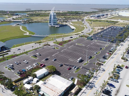 Port Canaveral's Exploration Tower is in the background of this photo of Port Canaveral's new 337-space Cove-area parking lot, in the foreground, and a resealed and restriped existing 225-space lot, to the right.