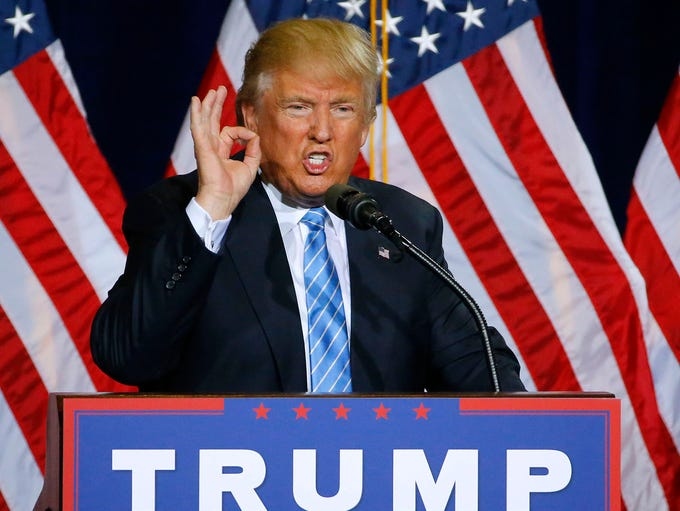 Presidential candidate Donald Trump gestures as he
