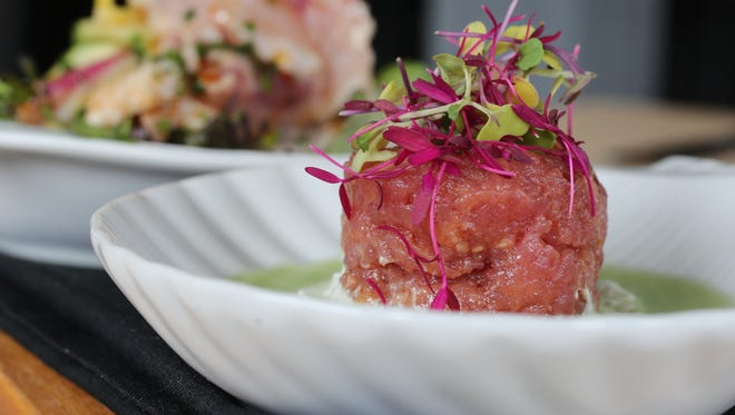 The yellowfin tuna tartare, front, and Day Boat Ceviche, rear, at 251 Lex will not be featured on the menu of Chef Kalandranis' new restaurant, Popojito.
