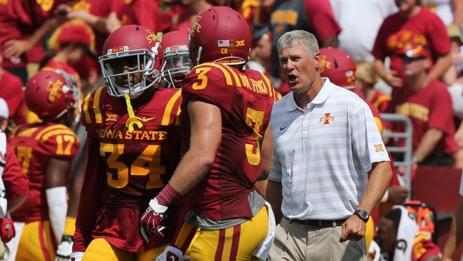 Paul Rhoads, ISU head coach, talks to some of his players as they get ready for the last few minutes of the game. Iowa State played North Dakota State in their opening game Saturday, Aug. 30, 2014. ISU lost to NDSU 34-14.
