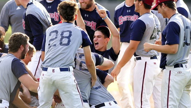 Eastern players celebrate their 4-1 win over St. Augustine in Monday's Diamond Classic final at Eastern High School.