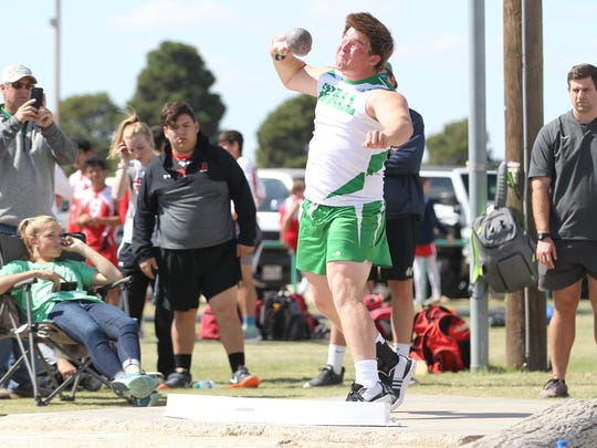 Wall High School shot putter Carson Stephens gets ready to throw the shot put at the Cotton Patch Relays in Wall on Thursday, March 29, 2018.