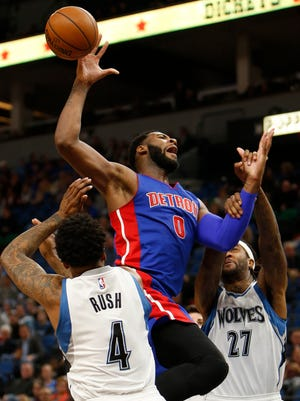 Pistons center Andre Drummond is fouled by Timberwolves forward Jordan Hill (27) in the second half of the Pistons' 117-90 win Friday, Dec. 9, 2016 in Minneapolis.
