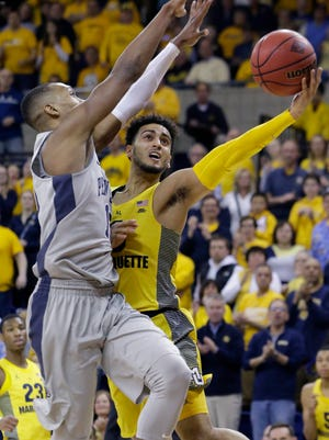 Marquette guard Markus Howard drives to basket at the Al McGuire Center during last season's NIT.