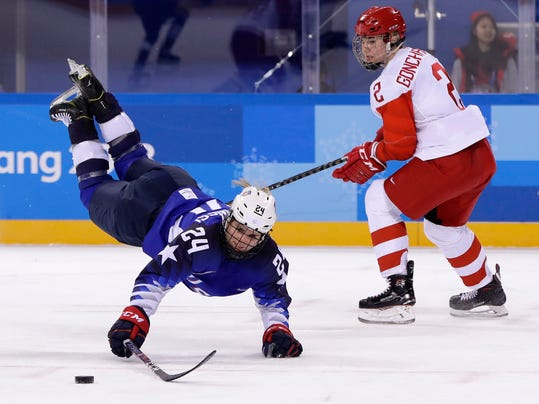 Dani Cameranesi (24), of the United States, chases the puck against Russian athlete Angelina Goncharenko (2) during the third period of the preliminary round of the women's hockey game at the 2018 Winter Olympics in Gangneung, South Korea, Tuesday, Feb. 13, 2018. (AP Photo/Matt Slocum)