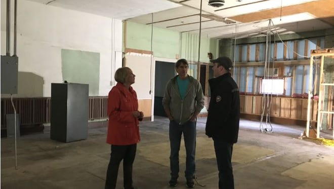 Cypress Hill Winery is moving to 51 E. Fourth St. and Rick and Carol Taylor are adding a restaurant, Hudson & Essex. From left, Forest Helsturm, wine manager; Carol Taylor; and Ben Hoggard, chef and managing partner, look over the large area that will house the new restaurant.
