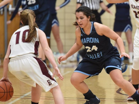 Hardin Valley's Paige Gentry (24) defends as Bearden's Holly Hagood (10) drives downcourt during a high school basketball game at Bearden High School in Knoxville on Monday, Feb. 29, 2016.