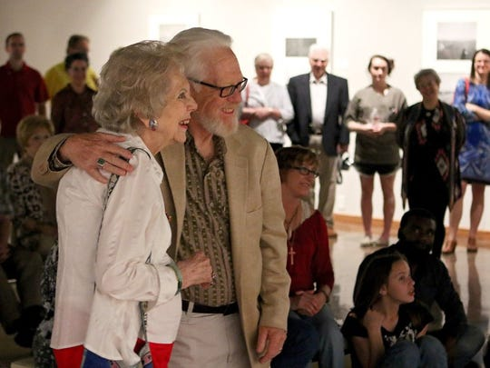 Patrick Johnston/Times Record News Frank Gohlke is greeted by Mary K. Carroll, his fifth-grade teacher at Crockett Elementary, during a reception for the opening of the 'Aftermath: The Wichita Falls Tornado' exhibit Thursday evening at the Wichita Falls Museum of Arts.