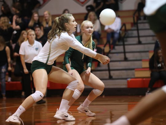 Lincoln's Kaylyn Buchanan digs a ball against Chiles during their District 2-8A semifinal at Leon High School.