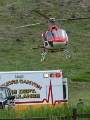 A helicopter takes off from the Hewlett Gulch Trailhead