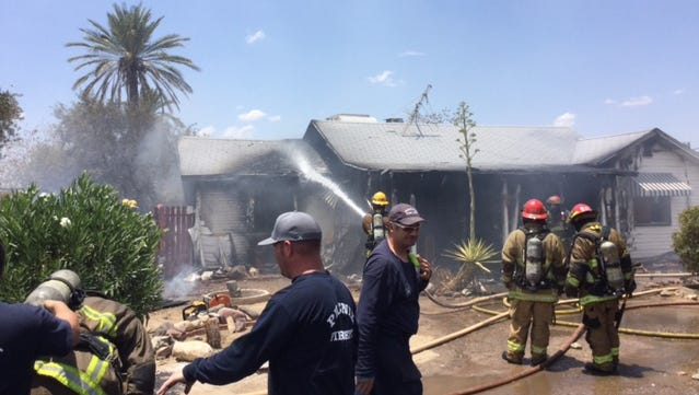 Phoenix fire fighters battled a home blaze Saturday.