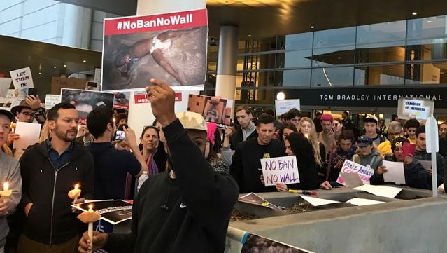Demonstrators protest President Donald Trump's immigration ban Saturday evening at the Tom Bradley International Terminal at Los Angles International Airport.