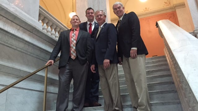 From left, Benton-Carroll-Salem Superintendent Guy Parmigian, treasurer Cajon Keeton, Rep. Steve Arndt, and Sen. Randy Gardner at the State Capitol  following a meeting to discuss the school district's loss in revenue due to the devaluation of equipment at the Davis-Besse Nuclear Power Plant.