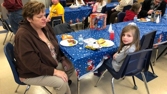 From left, mentor Cheryl LaFrance and student Hailey Sutton participate in Woodrow Wilson Elementary School's lunch buddy program.