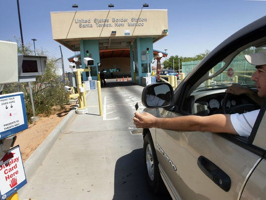 A border crosser scans his immigration document as he approaches the inspection station in Santa Teresa, New Mexico.