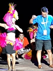 One of the coaches of the De La Salle University's All-Star Select team enjoys an impromptu dance at the Tao Tao Tasi dinner show.  The DLSU team visited Guam for the Pacific Summer Invitational U15 Basketball Tournament and were able to take in some of our cultural events.