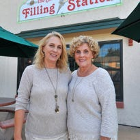 From left: Kim Michels, manager, and her mother Jackie Lovretich, co-owner, pose for a photo Wednesday at Sixth Street Filling Station in Wausau.