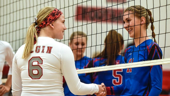Highland's Ashton Terrill, right, shakes hands with former classmate Madison Forbis before the start of Tuesday's volleyball match at Elgin. Terrill, who still lives in Prospect, had gone to Highland since the fourth grade.