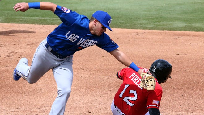 Las Vegas second baseman Gavin Cecchini reaches with the tag too late as Jose Pirela of the El Paso Chihuahuas slides into the base safely Sunday at Southwest University Park.
