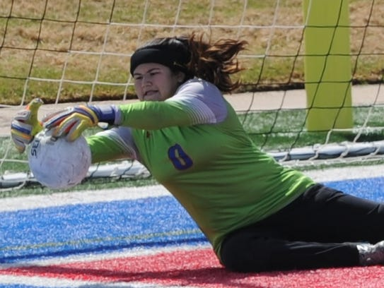 Cooper goalie Brandy Hagood makes a stop in the second