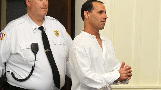 In an April 30, 2014, file photo, Jeffrey Roberio, the man convicted of killing 79-year-old Lewis Jennings in 1986 in his Middleboro home, appears in Brockton Superior Court.