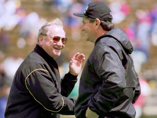 Colorado football coach Bill McCartney, right, meets