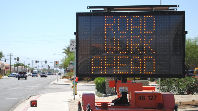 A sign telling drivers of upcoming roadwork is seen in this June 2012 file photo taken along Ramon Road in Cathedral City.